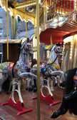 Beautiful vivid carousel with horses — Stock Photo