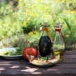 Piece of pizza in the summer garden table — Stock Photo