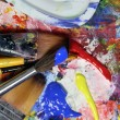 Art palette, paints and paintbrushes  — Stock Photo