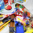 Art palette, tubes with paints and paintbrushes — Stock Photo #30043317