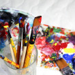 Art palette, tubes with paints and paintbrushes — Stock Photo #30043347