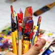 Art palette, tubes with paints and paintbrushes — Stock Photo