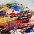 Art palette, tubes with paints and paintbrushes — Stock Photo #30043469
