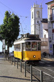 Historical Lisbon yellow tramway in vivid colors — Stockfoto