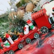 Christmas for children with toy red train — Stock Photo