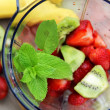 Fresh fruits in the blender — Stock Photo