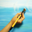 Painter paints his beautiful picture — Stock Photo #35492559