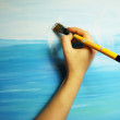 Painter paints his beautiful picture — Stock Photo