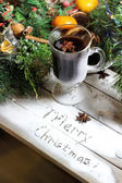 Traditional Christmas punch on the wooden background — Stock Photo