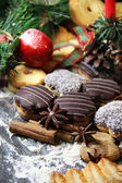 Mix of Christmas cookies with cinnamon and candle — Stock Photo