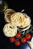 Traditional Italian food tagliatelle with ingredients — Stock Photo