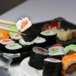 Mix of Japanese sushi and rolls — Zdjęcie stockowe
