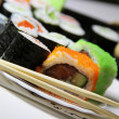 Mix of Japanese sushi and rolls — Stock Photo