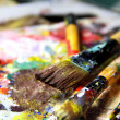 Stock Photo: Beautiful vivid art palette and mix of paintbrushes