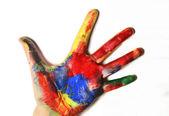 Beautiful vivid multicolored woman hand — Stock Photo