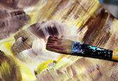Paintbrush and beautiful painting of flowers — Stock Photo
