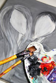 Paintbrush and beautiful painting with pair in love — Stock Photo