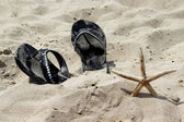 Summer shoes on the beach and starfish — Stock Photo