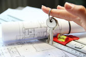 Architecture project on the table with tools and keys — Stock Photo