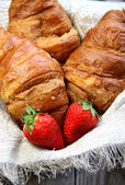 Fresh French croissant on the table — Стоковое фото
