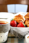 Fresh French croissant on the table — Stok fotoğraf