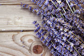 Lavender flowers on the wooden background  — Stock Photo