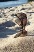 Female sunglasses on the beach, sun and sand — Stock Photo