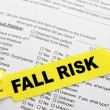 Stock Photo: Fall Risk With Hospital Paperwork