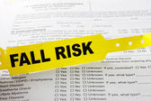 Fall Risk Bracelet On Top Of Hospital Questionnaire — Stock Photo