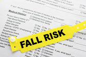 Fall Risk With Hospital Paperwork — Stock Photo