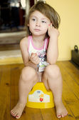 Girl on potty — Stockfoto
