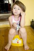 Girl on potty — Stock Photo
