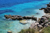 Pictorial blue Ionian sea with rocks — Stock Photo