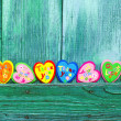 Decorative hearts on wooden background — Stock Photo #18678211