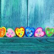 Decorative hearts on wooden background — Stock Photo #18680065