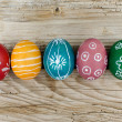 Stock Photo: Easter Eggs on wooden background