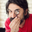 Attractive Man with Magnifying Glass — Stock Photo