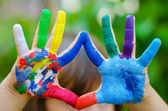 Painted colorful hands — Stock Photo