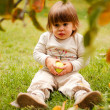 Adorable baby girl sitting in grass — Stock Photo