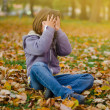 Stock Photo: Girl playing hide and seek in park