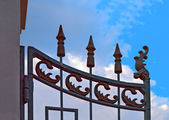 Wrought iron gate against blue sky — Stock Photo