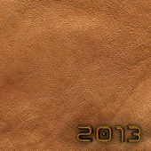 Leather new year 2013 background. Brown. — Stock Photo