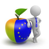 Apple with United Europe flag and businessman — Stock Photo