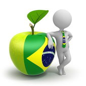 Apple with Brasilian flag and businessman — Stock Photo