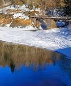 Wooden bridge in winter park — Stock Photo