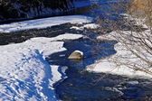 River in winter under snow — Foto Stock