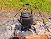 Teapot on the campfire — Stock Photo