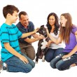 Happy family welcoming a new dog — Stock Photo #46981159