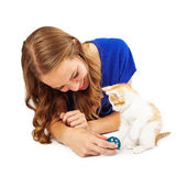 Young Adult Female Playing With Kitten — Stock Photo