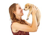 Pretty Girl Picking Up Little Puppy — Stock Photo